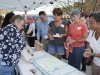 BI Special Events Director Rita Pacyga serves cake to BI residents